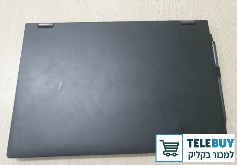 תמונה של מחשב נייד Lenovo בבית-שמש והסביבה